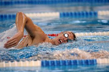 sport swimming to slim down the belly